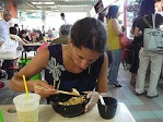 eating at a hawker centre in Singapore
