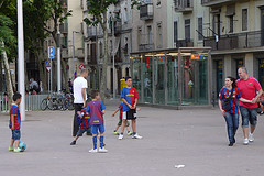 Kids playing soccer in Barcelona