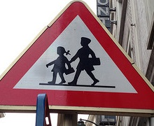 A school crossing sign at a public school in Brussels