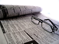 Doing business in Malaysia - newspaper and glasses