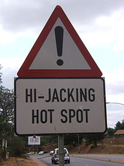 Hijacking in South Africa road sign - copyright hmvh @ Flickr