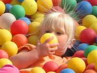 child playing in plastic balls