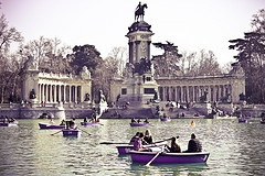 Parents and children having fun at Retiro Park in Madrid