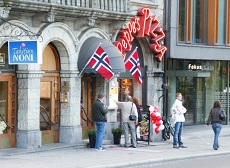 Consumers outside a restaurant in Norway