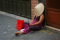 Asian woman sleeping on the street of southeast asia